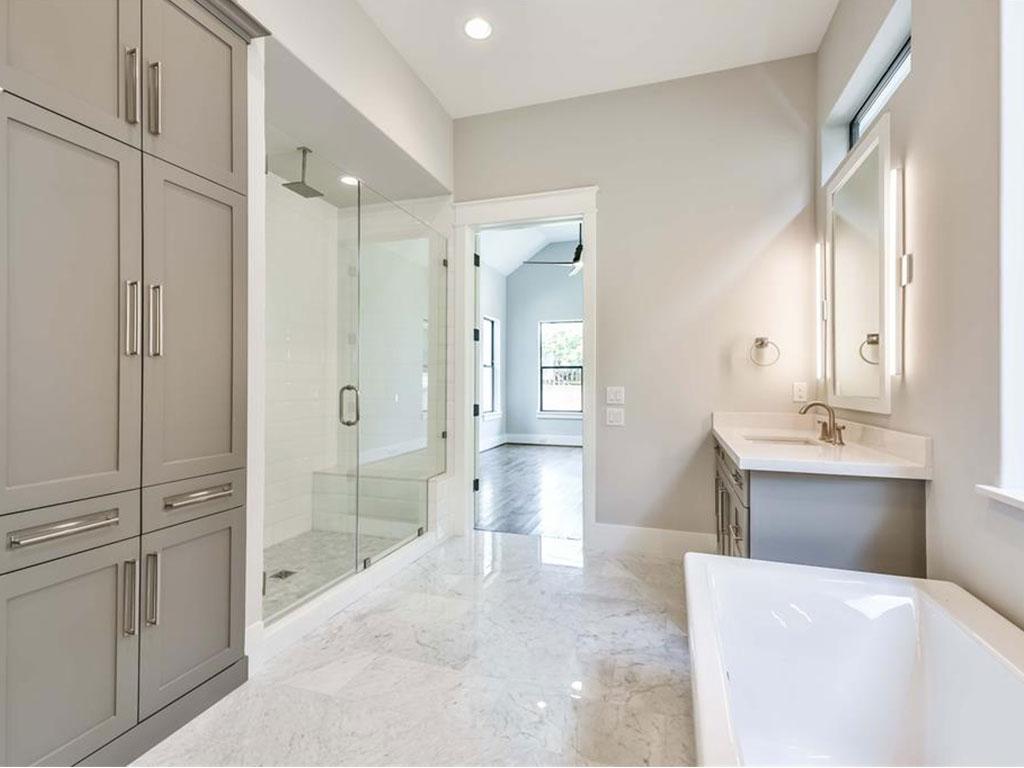 Linen cabinets provide abundant storage.