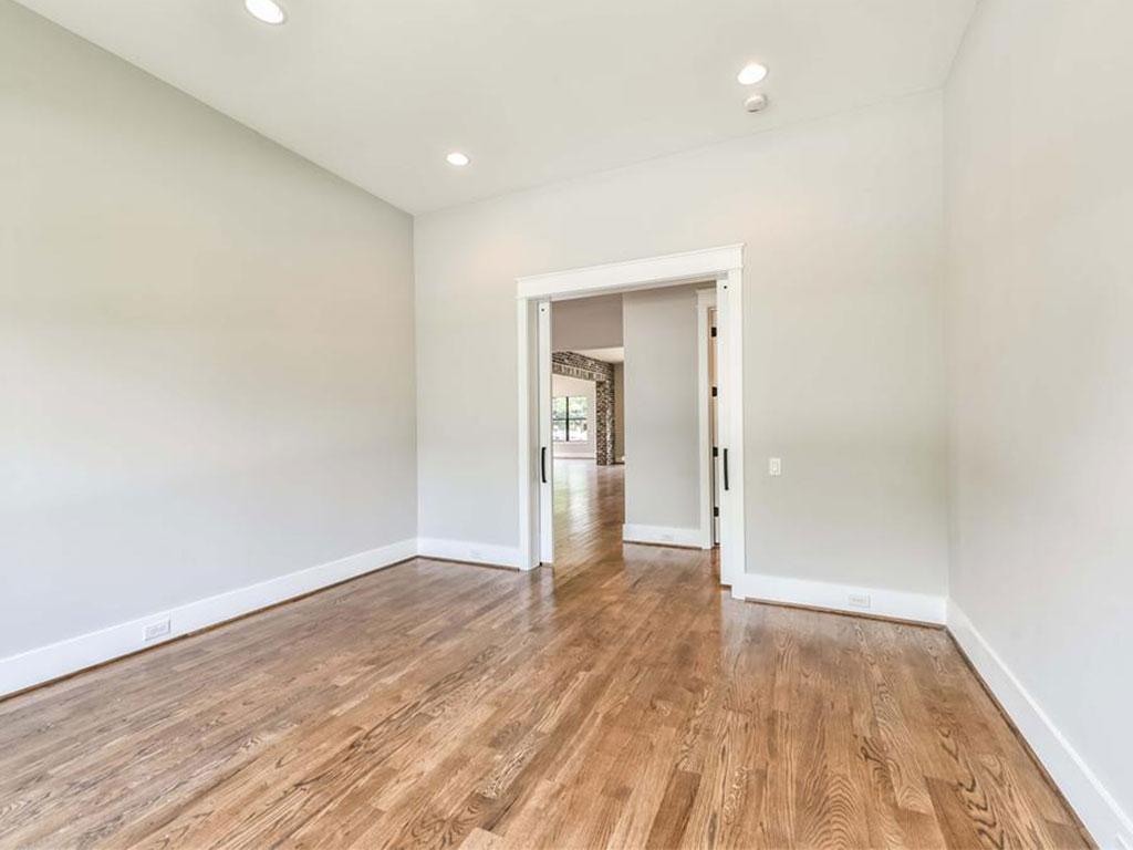 Downstairs study through double barn doors.