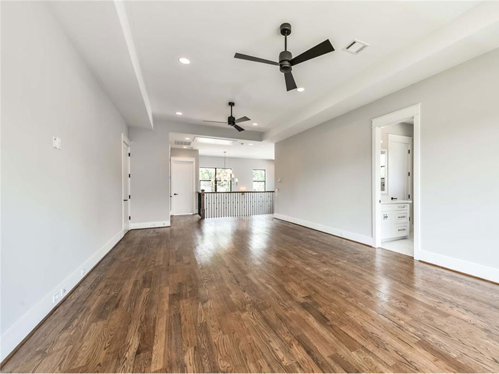 Impressive game room with tray ceiling and access to the secondary bedrooms and baths.