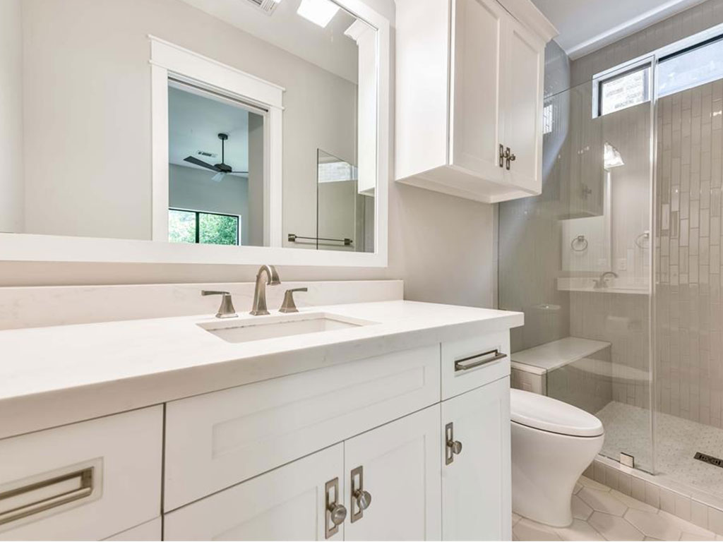 Secondary bathroom on the second floor boasts stylish hardware and stand up shower with designer tile surround.