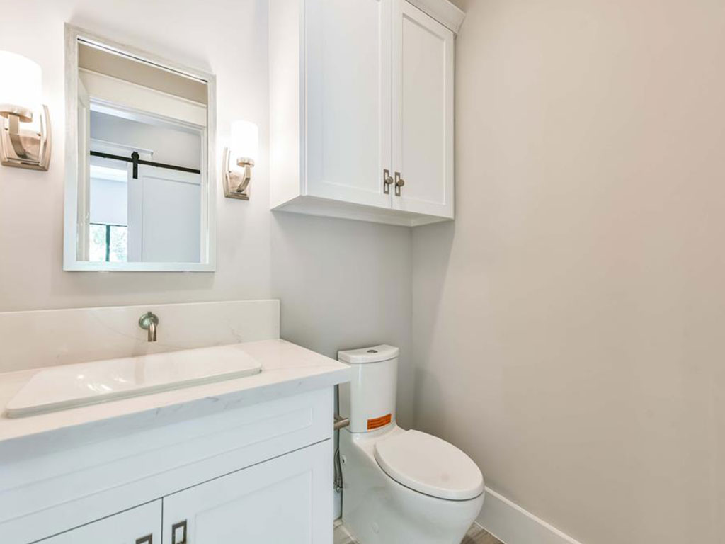 Powder bath on the first story is just off the study and features designer light fixtures and hardware.