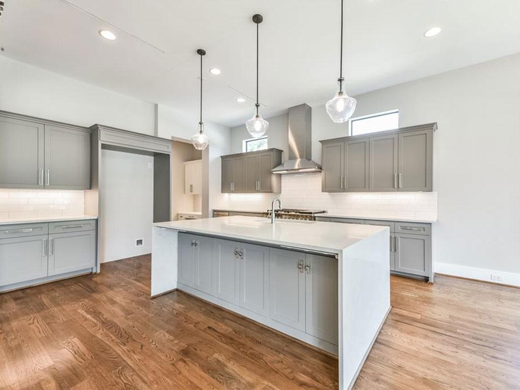 Gourmet island kitchen offers designer pendant lighting, breakfast bar and professional grade gas range.