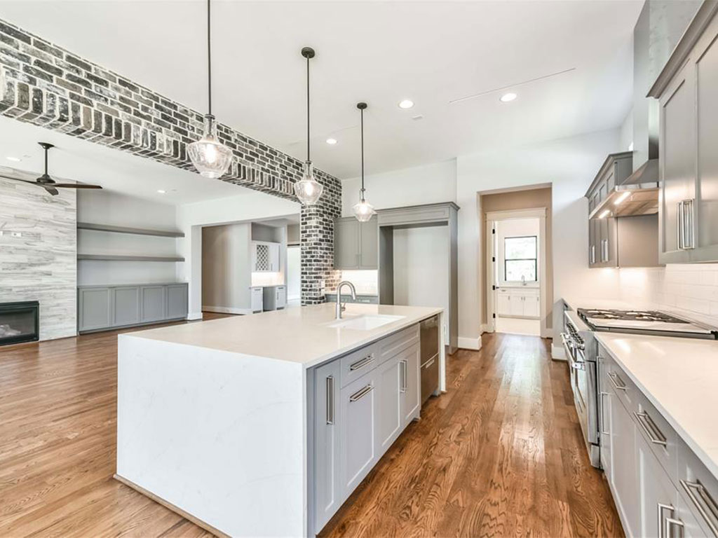 Incredible brick accent adds to the character of the spacious first floor entertaining area.