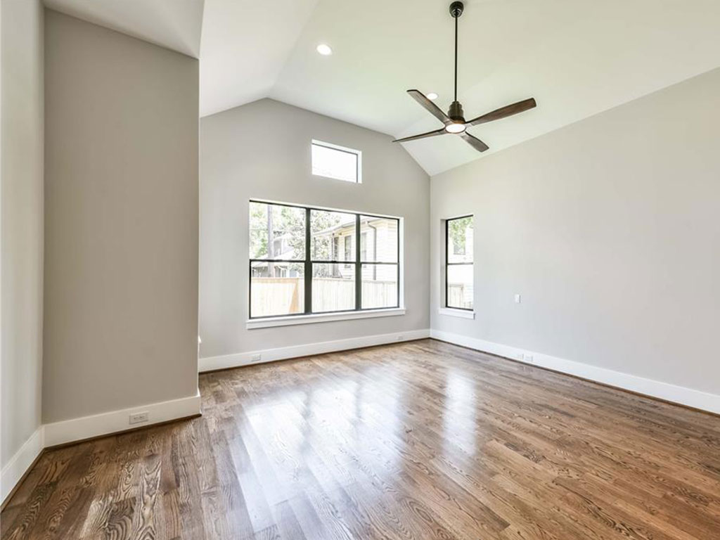 Master suite boasts vaulted ceiling and luxurious bath complete with custom master closet.
