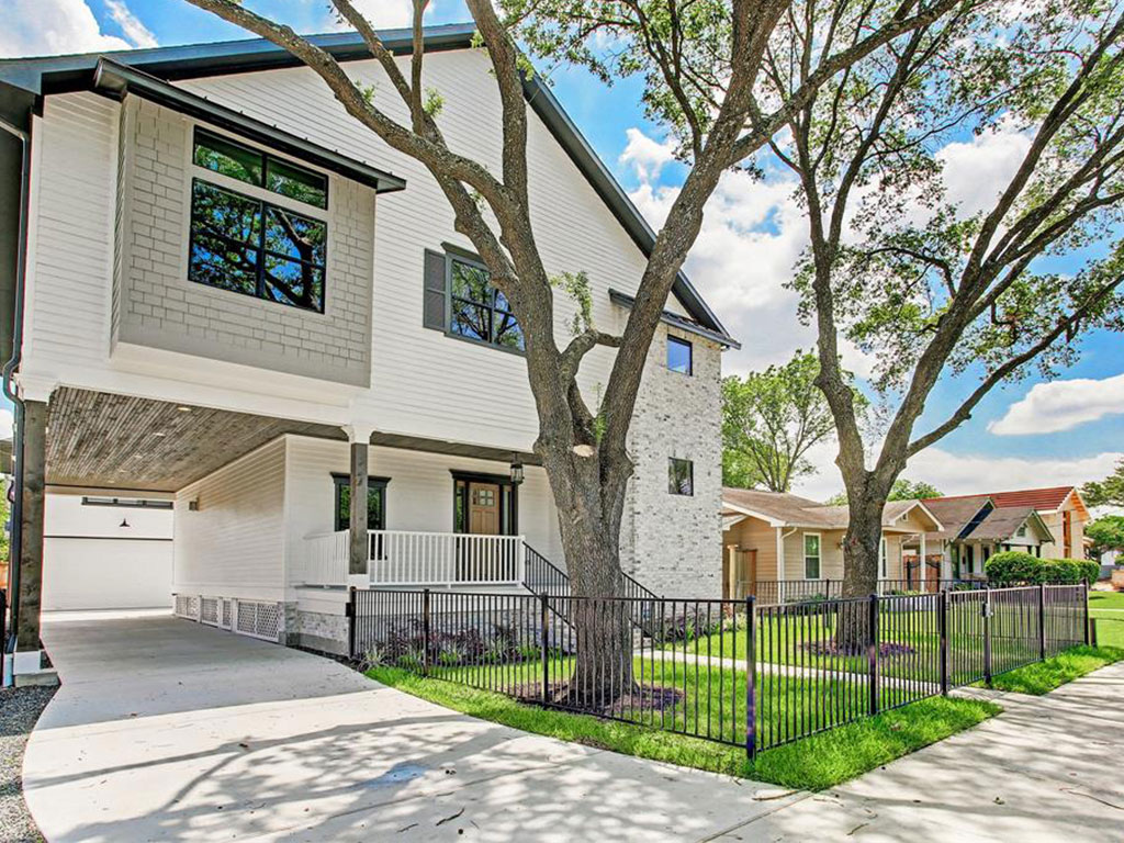Great curb appeal and attractive elevation with a huge front porch. Gated front yard and electric driveway gate with dramatic porte cochere.