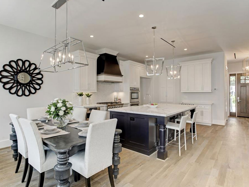 Lovely dining area off the kitchen with designer contemporary lighting.