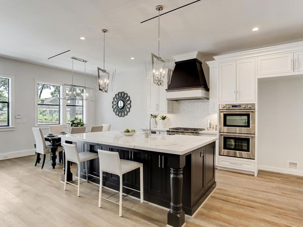 The gourmet kitchen has high end Fisher and Paykel double ovens, top/bottom double dishwashers, Sharp microwave drawer and Zephyr custom built vent hood. Space built out for extra wide built-in refrigerator.