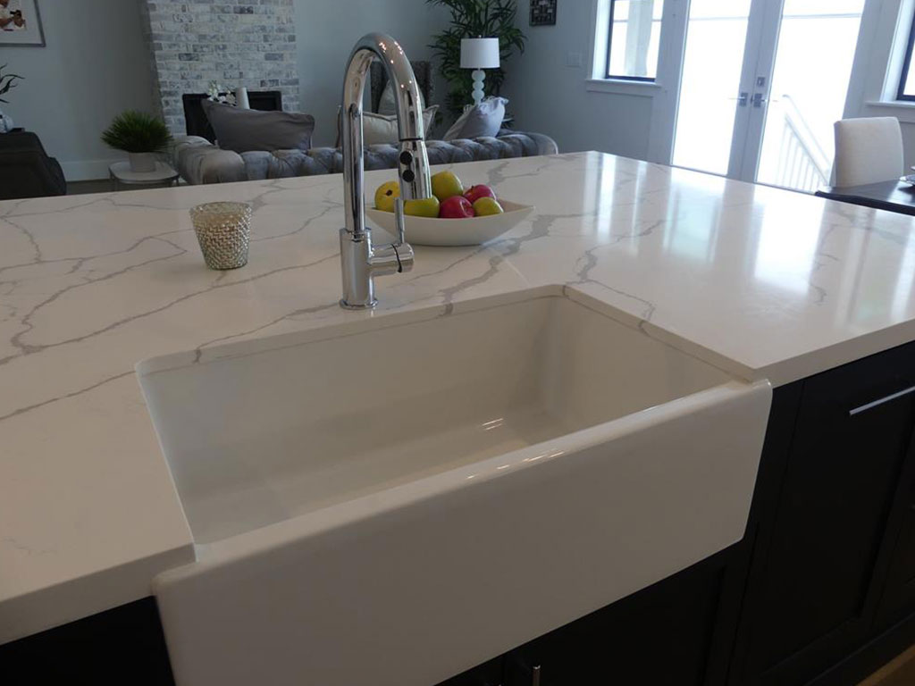 Huge island with so much prep space with farmhouse sink.