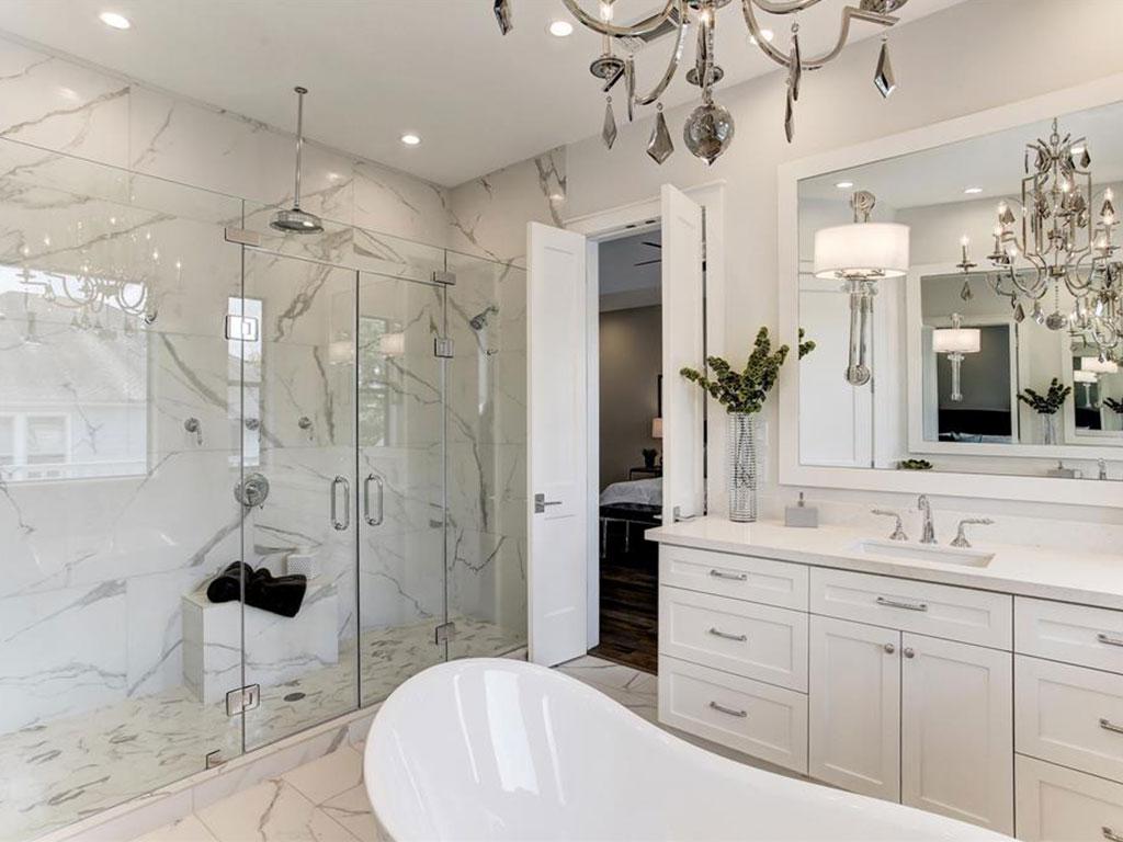 Massive shower with extra thick seamless glass and Calacatta quartz shower wall.