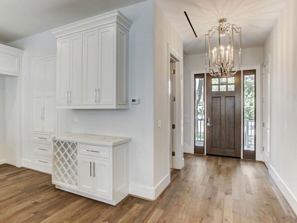 Picturesque entry features designer chandelier.