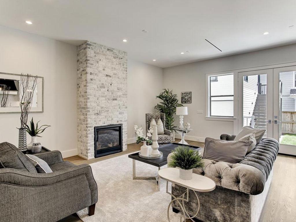 Spacious 20' x 14' living room with impressive brick gas log fireplace.