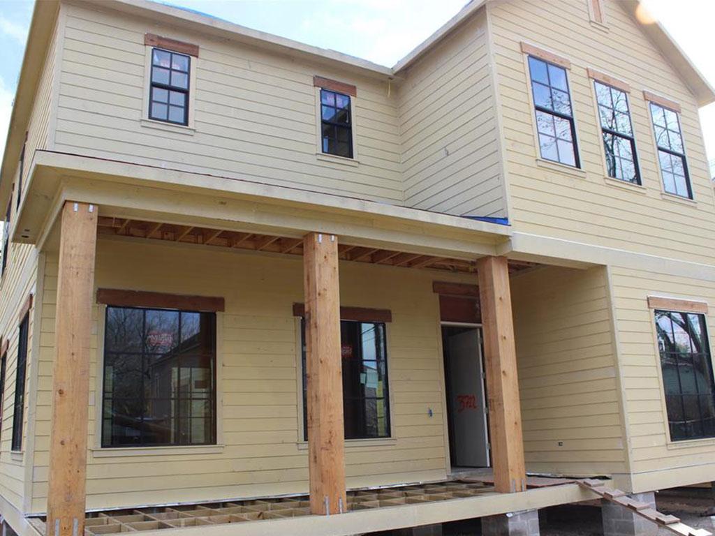 Front exterior showing construction progress